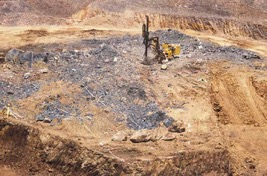 Large open pit Australian owned gold mine in southern Laos